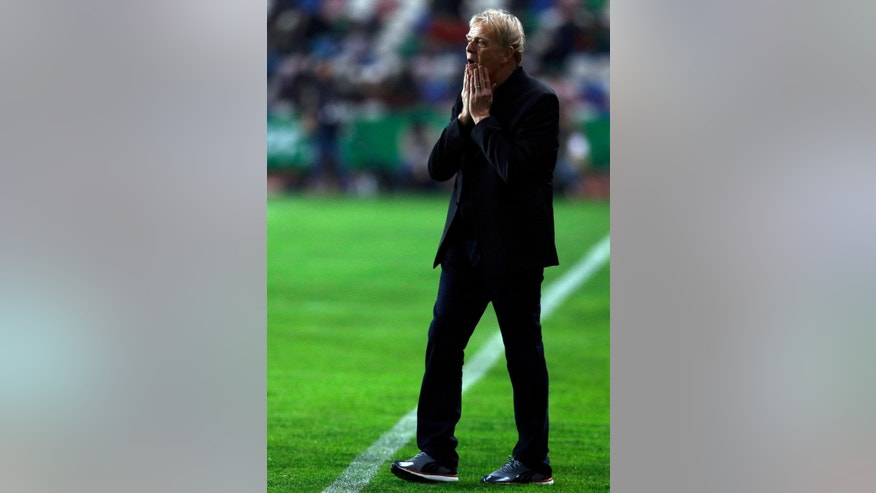 FILE - In this March 5 2014, file photo, Cameroon's coach Volker Finke, from Germany, walks on the sidelines before their friendly soccer match with Portugal, in Leiria, Portugal. (AP Photo/Armando Franca,File)