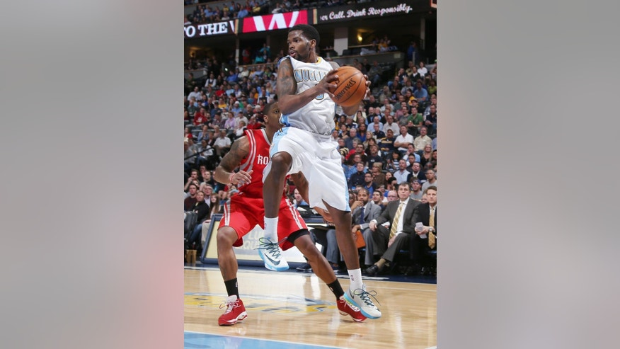 Denver Nuggets guard Aaron Brooks, front, pulls in a loose ball in front of Houston Rockets guard Isaiah Canaan in the first quarter of an NBA basketball game in Denver on Wednesday, April 9, 2014. (AP Photo/David Zalubowski)