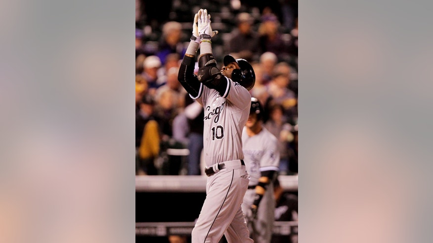 Chicago White Sox Alexei Ramirez looks upward after hitting a home run during the eighth inning of a baseball game against the Colorado Rockies, Tuesday, April 8, 2014, in Denver. (AP Photo/Barry Gutierrez)