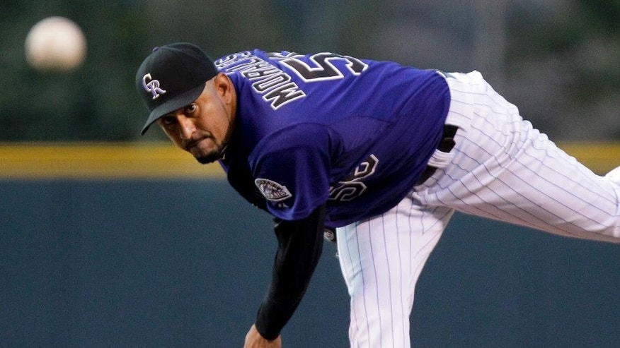 Colorado Rockies starting pitcher Franklin Morales challenges Chicago White Sox Marcus Semien during the first inning of a baseball game, Tuesday, April 8, 2014, in Denver. (AP Photo/Barry Gutierrez)