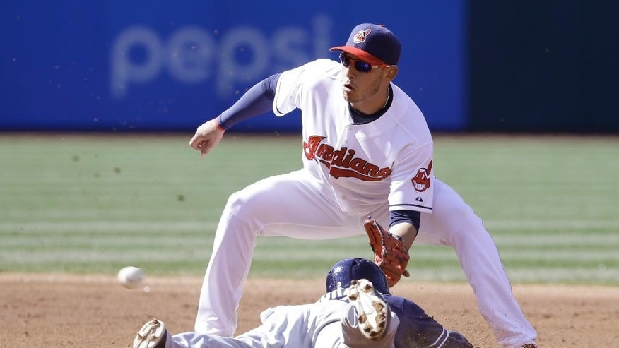 San Diego Padres' Everth Cabrera, bottom, slides safely into second base as Cleveland Indians' Asdrubal Cabrera waits for the ball during the third inning in the second game of a baseball doubleheader on Wednesday, April 9, 2014, in Cleveland.  (AP Photo/Tony Dejak)