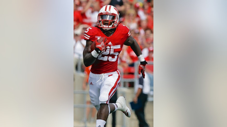 FILE - In this Aug. 31, 2013 file photo,  Wisconsin's Melvin Gordon breaks away for a touchdown in the first half of an NCAA college football game against Massachusetts, in Madison, Wis. Gordon averaged 128.8 yards a game and is the nation's second-leading returning rusher. Gordon and Nebraska's Ameer Abdullah are the nation's top two returning rushers and keys to their teams' bids to win the Big Ten West. (AP Photo/Morry Gash, File)