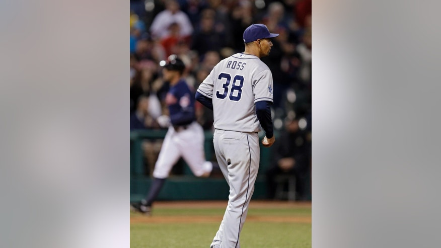 San Diego Padres starting pitcher Tyson Ross (38) walks back to the mound after giving up a three-run home run to Cleveland Indians' David Murphy in the fourth inning of the MLB baseball game Tuesday, April 8, 2014, in Cleveland. (AP Photo/Mark Duncan)