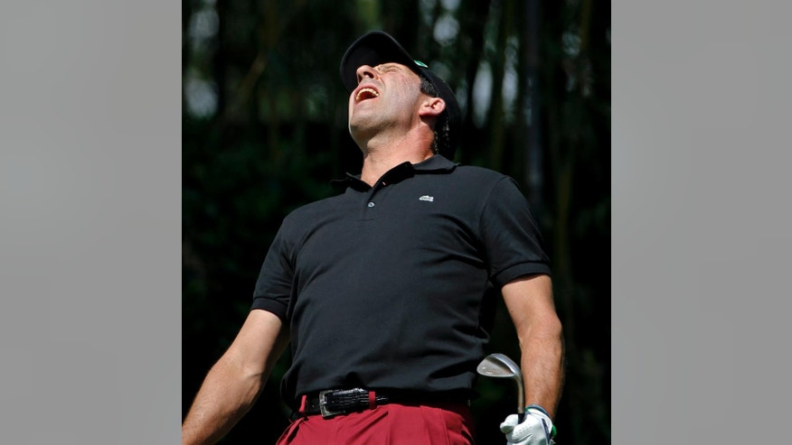 Jose Maria Olazabal, of Spain, reacts to his tee shot on the third hole during the par three competition at the Masters golf tournament Wednesday, April 9, 2014, in Augusta, Ga. (AP Photo/Matt Slocum)