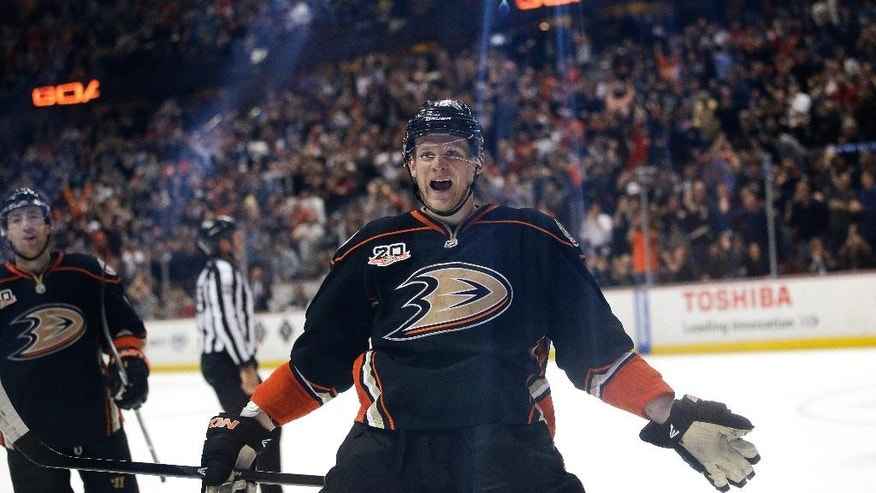 Anaheim Ducks' Corey Perry celebrates a goal by teammate Matt Beleskey during the second period of an NHL hockey game against the San Jose Sharks on Wednesday, April 9, 2014, in Anaheim, Calif. (AP Photo/Jae C. Hong)