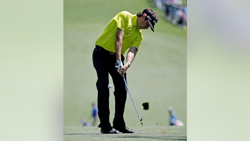 Bubba Watson hits off the first fairway during the first round of the Masters golf tournament Thursday, April 10, 2014, in Augusta, Ga. (AP Photo/Charlie Riedel)