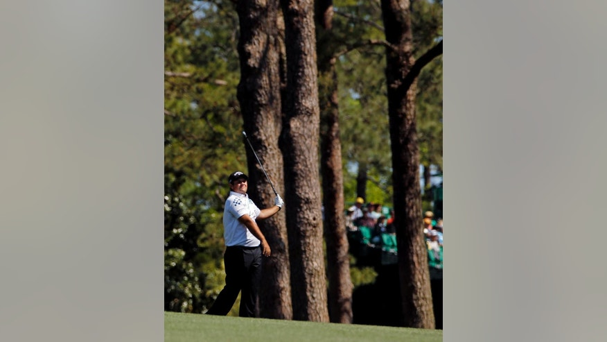 Patrick Reed watches his shot on the third fairway during the first round of the Masters golf tournament Thursday, April 10, 2014, in Augusta, Ga. (AP Photo/Matt Slocum)