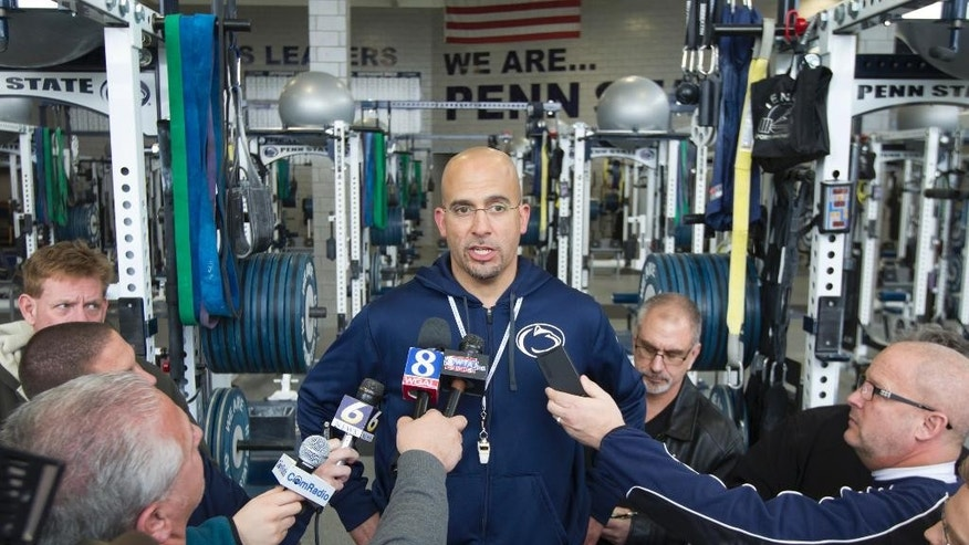 CORRECTS DAY AND DATE - Penn State coach James Franklin talks to reporters following the NCAA college football team's spring practice, Saturday, April 5, 2014, in State College, Pa. (AP Photo/PennLive.com. Joe Hermitt)