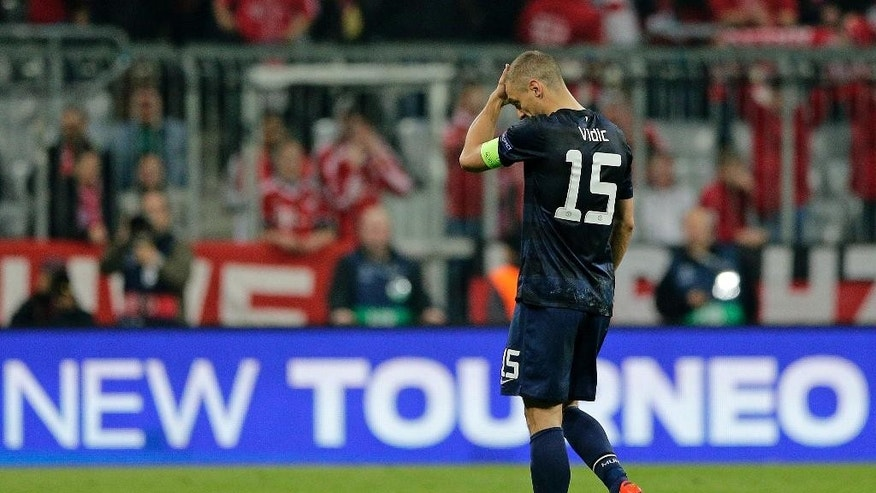 Manchester United's Nemanja Vidic leaves the field at the end of the Champions League quarterfinal second leg soccer match between Bayern Munich and Manchester United in the Allianz Arena in Munich, Germany, Wednesday, April 9, 2014. Bayern won 3-1 to win the tie 4-2 on aggregate.(AP Photo/Matthias Schrader)