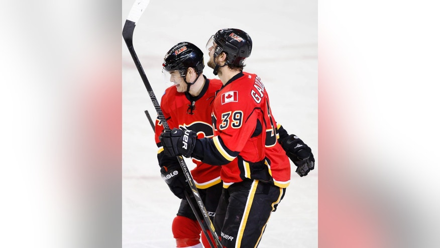 Calgary Flames' TJ Galiardi, right, celebrates his goal against the Los Angeles Kings with Jiri Hudler, from the Czech Republic, during first period NHL action in Calgary, Alta., Wednesday, April 9, 2014.  (AP Photo/The Canadian Press, Larry MacDougal)