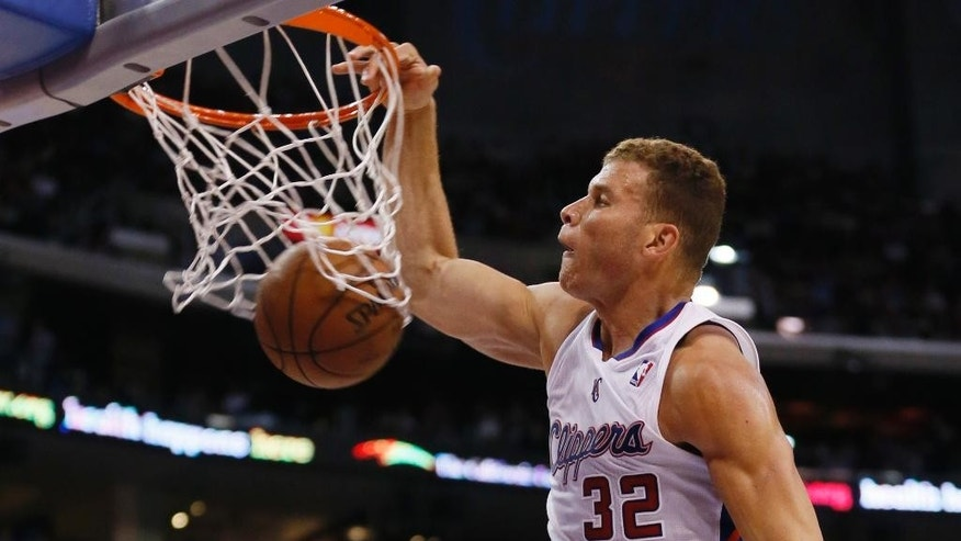 Los Angeles Clippers forward Blake Griffin dunks against the Oklahoma City Thunder during the first half of an NBA basketball game in Los Angeles, Wednesday, April 9, 2014. (AP Photo/Danny Moloshok)