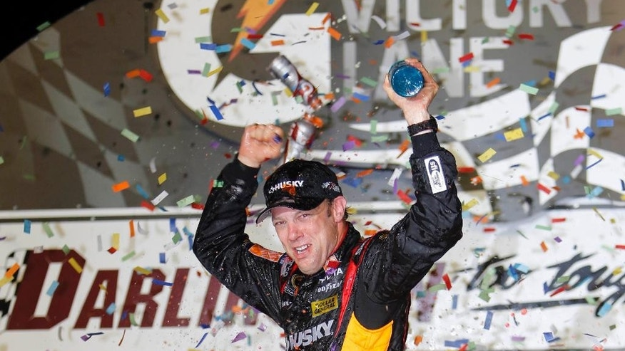 FILE - In this May 11, 2013 file photo, Matt Kenseth celebrates in Victory Lane after winning the NASCAR Sprint Cup series auto race at Darlington Raceway in Darlington, S.C. Kenseth hopes a second straight win at Darlington Raceway will lock him into the championship chase this weekend.   (AP Photo/Mic Smith, File)