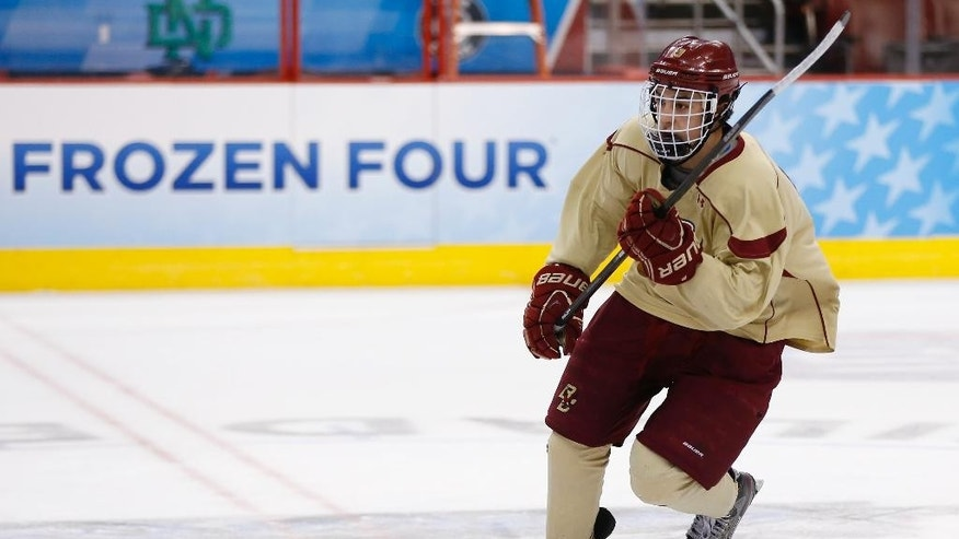 Boston College's Johnny Gaudreau skates down the ice during team practice for the NCAA men's college hockey Frozen Four tournament Wednesday, April 9, 2014, in Philadelphia. Boston faces Union in a semifinal match on Thursday. (AP Photo/Matt Rourke)