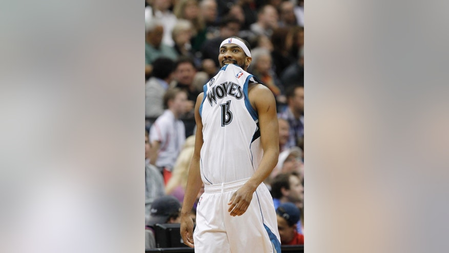Minnesota Timberwolves forward Corey Brewer walks downcourt as a teammate shoots a free throw during the second quarter of an NBA basketball game against the Houston Rockets in Minneapolis, Friday, April 11, 2014. (AP Photo/Ann Heisenfelt)