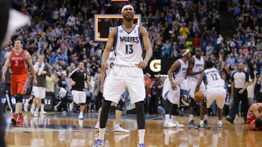 Minnesota Timberwolves forward Corey Brewer reacts after the Timberwolves defeated the Houston Rockets 112-110 during an NBA basketball game in Minneapolis, Friday, April 11, 2014. (AP Photo/Ann Heisenfelt)