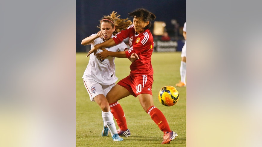 China defender Liu Shanshan, right, fouls U,S, midfielder Heather O'Reilly while cutting off her drive during the first half of an international friendly soccer match Thursday, April 10, 2014, in San Diego. (AP Photo/Lenny Ignelzi)