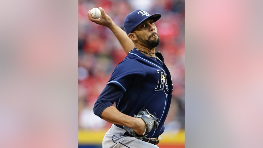 Tampa Bay Rays starting pitcher David Price throws against the Cincinnati Reds in the first inning of a baseball game, Friday, April 11, 2014, in Cincinnati. (AP Photo/Al Behrman)