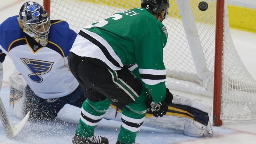 Dallas Stars defenseman Trevor Daley (6) scores a goal against St. Louis Blues goalie Ryan Miller during the second period of an NHL hockey game Friday, April 11, 2014, in Dallas. (AP Photo/LM Otero)