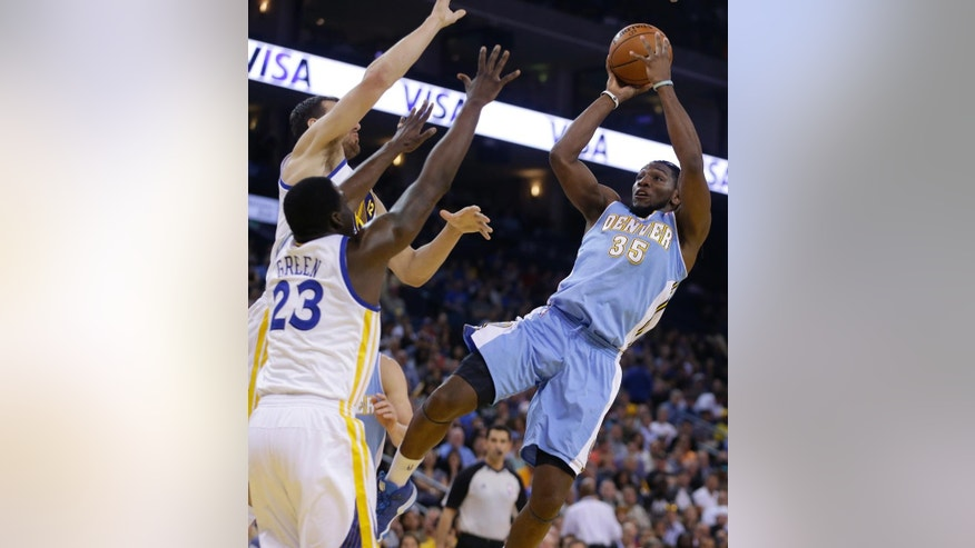 Denver Nuggets' Kenneth Faried, right, shoots against Golden State Warriors' Draymond Green (23) and Andrew Bogut during the first half of an NBA basketball game Thursday, April 10, 2014, in Oakland, Calif. (AP Photo/Ben Margot)