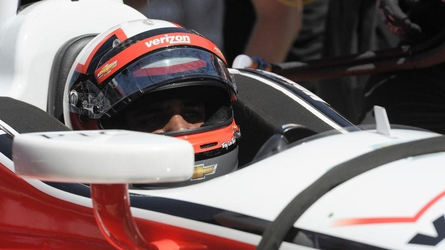 Juan Pablo Montoya, of Colombia, stops in the pits during the practice for the IndyCar series Toyota Grand Prix of Long Beach auto race in Long Beach, Calif., Friday, April 11, 2014. (AP Photo/Kelvin Kuo)