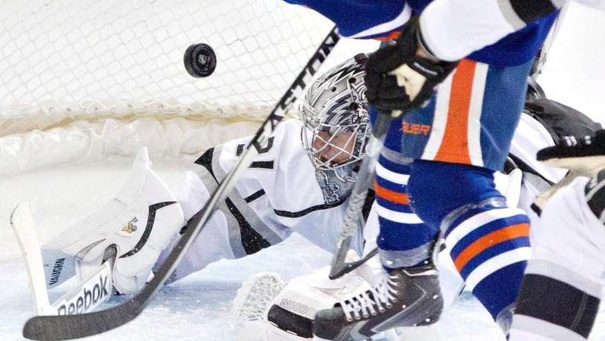 Los Angeles Kings goalie Martin Jones (31) makes the save on Edmonton Oilers' Taylor Hall (4) during second-period NHL hockey game action in Edmonton, Alberta, Thursday, April 10, 2014. (AP Photo/The Canadian Press, Jason Franson)