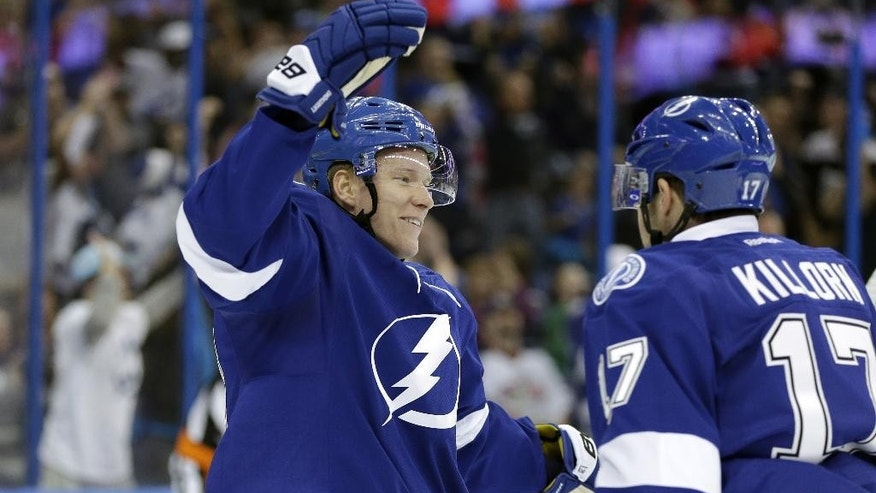 Tampa Bay Lightning left wing Ondrej Palat, of the Czech Republic,, left, celebrates with teammate Alex Killorn after scoring against the Columbus Blue Jackets during the second period of an NHL hockey game Friday, April 11, 2014, in Tampa, Fla. (AP Photo/Chris O'Meara)