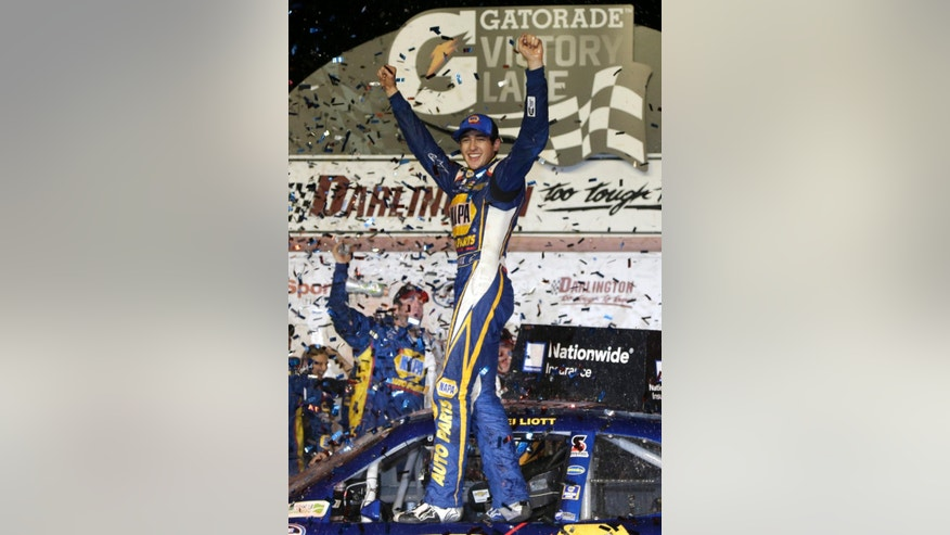 Chase Elliott celebrates in Victory lane after winning a NASCAR Nationwide series auto race at Darlington Speedway in Darlington, S.C., Friday, April 11, 2014. (AP Photo/Chuck Burton)
