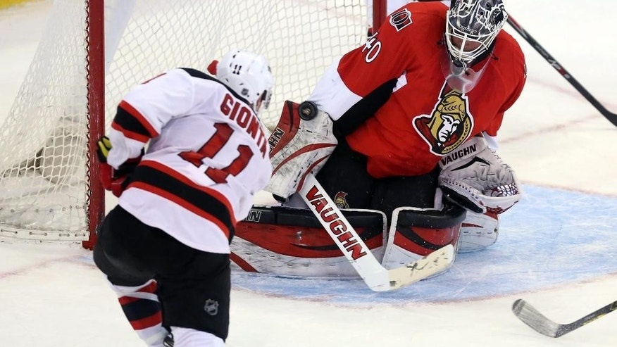 Ottawa Senators goaltender Robin Lehner (40) makes a blocker-save on New Jersey Devils' Stephen Gionta (11) during second-period NHL hockey game action in Ottawa, Ontario, Thursday, April 10, 2014. (AP Photo/The Canadian Press, Fred Chartrand)