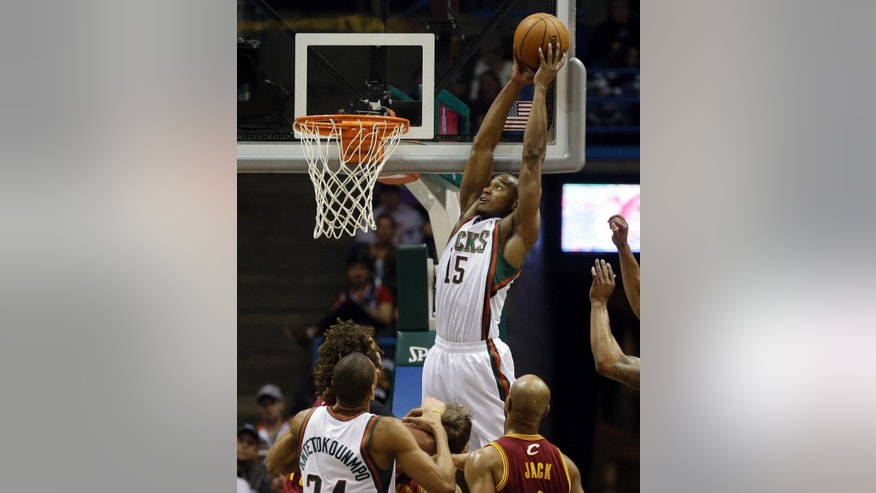 Milwaukee Bucks' Chris Wright (15) dunks against the Cleveland Cavaliers during the first half of an NBA basketball game Friday, April 11, 2014, in Milwaukee. (AP Photo/Jeffrey Phelps)