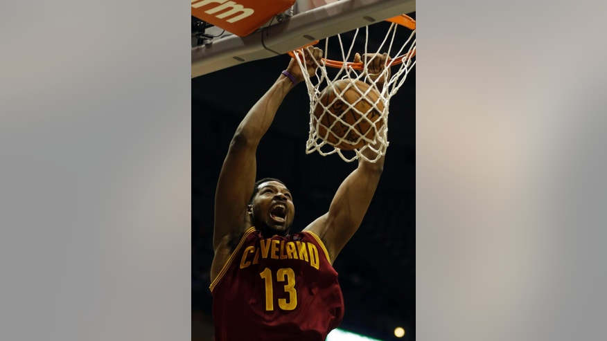 Cleveland Cavaliers' Tristan Thompson dunks against the Milwaukee Bucks during the first half of an NBA basketball game Friday, April 11, 2014, in Milwaukee. (AP Photo/Jeffrey Phelps)