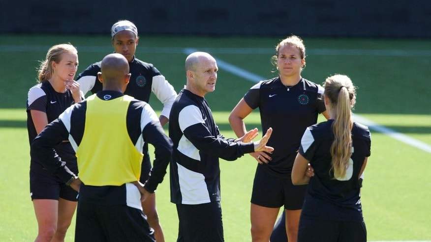 In this April 9, 2014 photo, Portland Thorns head coach Paul Riley talks with his teams during practice in Portland, Ore. The defending NWSL champion Thorns will open the season Saturday, April 12, against the expansion Houston Dash in Houston. (AP Photo/The Oregonian, Randy L. Rasmussen)