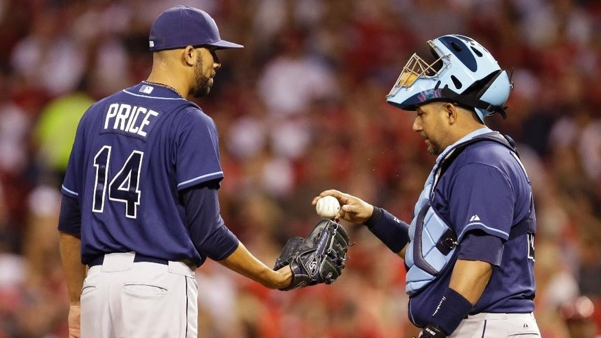 Tampa Bay Rays starting pitcher David Price (14) talks with catcher Jose Molina in the third inning of a baseball game against the Cincinnati Reds, Friday, April 11, 2014, in Cincinnati. (AP Photo/Al Behrman)