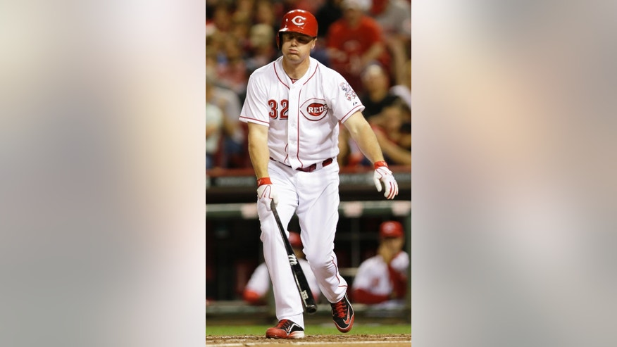 Cincinnati Reds' Jay Bruce strikes out against Tampa Bay Rays starting pitcher David Price in the fourth inning of a baseball game, Friday, April 11, 2014, in Cincinnati. (AP Photo/Al Behrman)