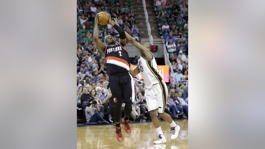 Utah Jazz's Alec Burks (10) fouls Portland Trail Blazers' Wesley Matthews (2) in the second quarter during an NBA basketball game on Friday, April 11, 2014, in Salt Lake City. (AP Photo/Rick Bowmer)