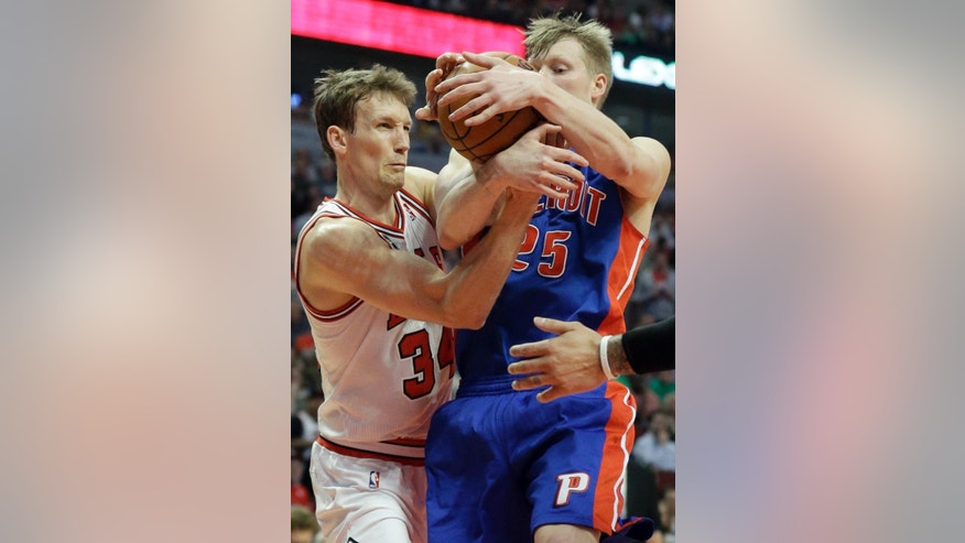 Detroit Pistons forward Kyle Singler, right, and Chicago Bulls guard Mike Dunleavy (34) battle for a rebound during the first half of an NBA basketball game in Chicago on Friday, April 11, 2014. (AP Photo/Nam Y. Huh)