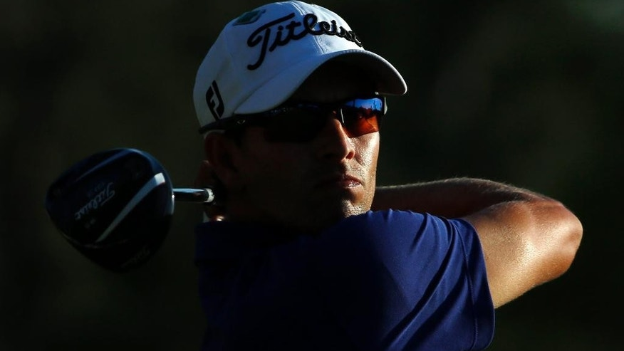 Adam Scott, of Australia, tees off during the third round of the Masters golf tournament Saturday, April 12, 2014, in Augusta, Ga. (AP Photo/David J. Phillip)