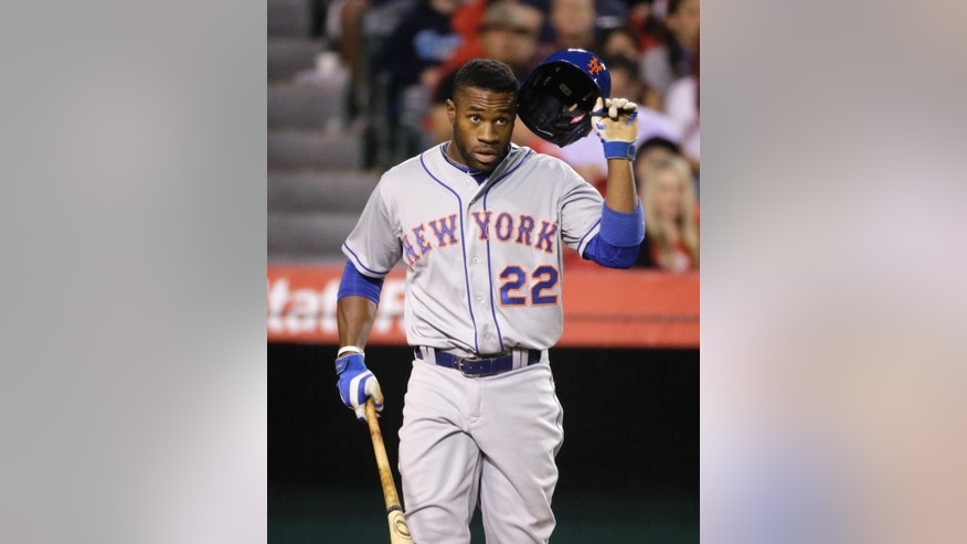 New York Mets' Eric Young Jr. takes off his helmet after he struck out against the Los Angeles Angels during the seventh inning of a baseball game Friday, April 11, 2014, in Anaheim, Calif. (AP Photo/Jae C. Hong)