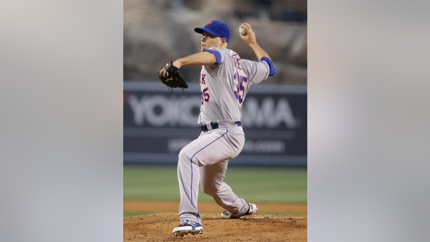 New York Mets starting pitcher Dillon Gee throws against the Los Angeles Angels during the first inning of a baseball game on Friday, April 11, 2014, in Anaheim, Calif. (AP Photo/Jae C. Hong)