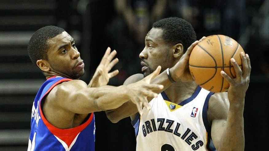 Philadelphia 76ers guard Hollis Thompson, left, defends Memphis Grizzlies guard Tony Allen (9) in the first half of an NBA basketball game on Friday, April 11, 2014, in Memphis, Tenn. (AP Photo/Mike Brown)
