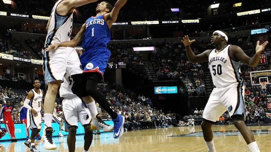 Memphis Grizzlies center Marc Gasol (33) blocks a shot by Philadelphia 76ers guard Michael Carter-Williams (1) as Grizzlies forward Zach Randolph (50) aids in the defense in the first half of an NBA basketball game on Friday, April 11, 2014, in Memphis, Tenn. (AP Photo/Mike Brown)