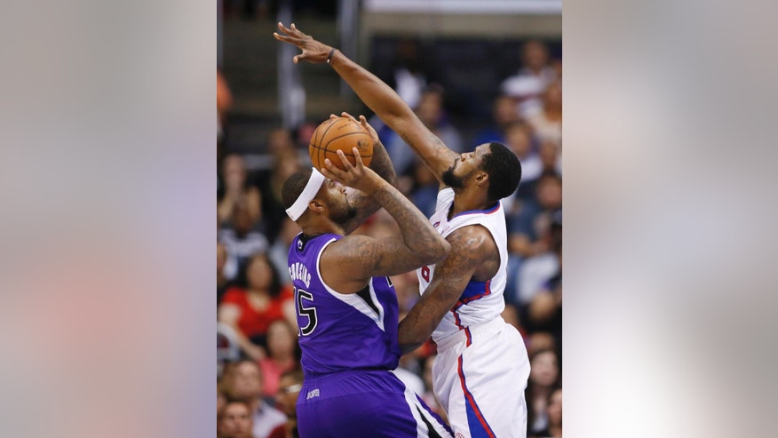 Sacramento Kings center DeMarcus Cousins shoots the ball as Los Angeles Clippers center DeAndre Jordan defends him during the first half of an NBA basketball game in Los Angeles, Sunday, April 12, 2014. (AP Photo/Danny Moloshok)