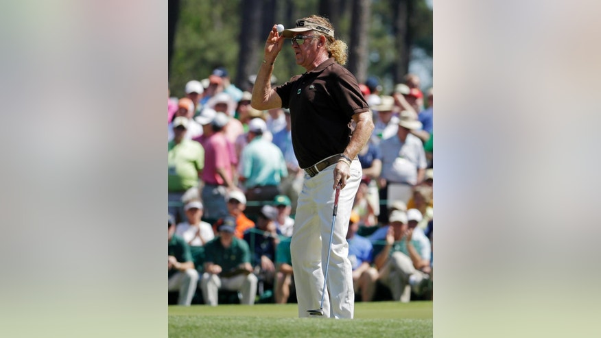 Miguel Angel Jimenez, of Spain, tips his cap after putting on the sixth hole during the third round of the Masters golf tournament Saturday, April 12, 2014, in Augusta, Ga. (AP Photo/Darron Cummings)