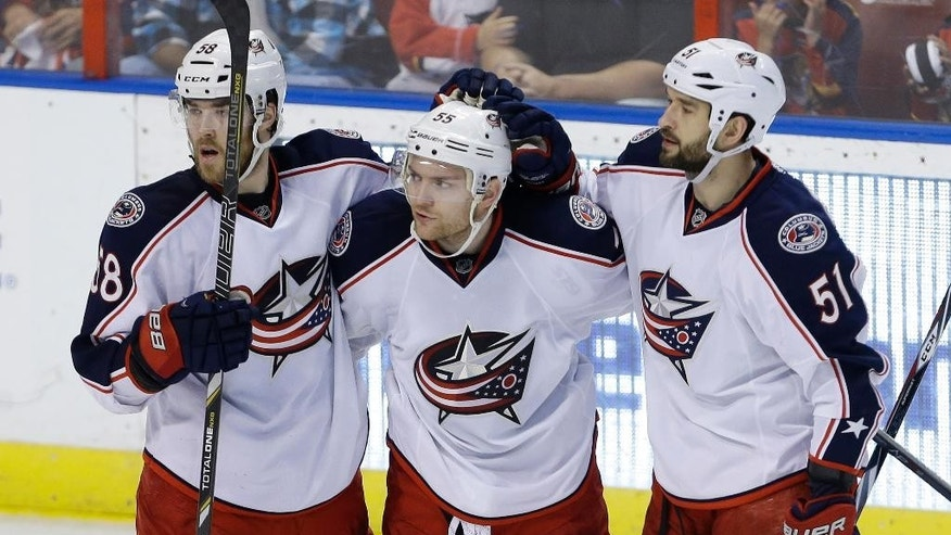 Florida Panthers center Jesse Winchester (17) gets caught in the jersey of Columbus Blue Jackets goalie Sergei Bobrovsky, right, in the second period of a hockey game, Saturday, April 12, 2014, in Sunrise, Fla. (AP Photo/Lynne Sladky)
