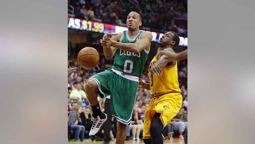 Boston Celtics' Avery Bradley (0) loses control of the ball against Cleveland Cavaliers' Dion Waiters (3) during the first quarter of an NBA basketball game Saturday, April 12, 2014, in Cleveland. (AP Photo/Tony Dejak)