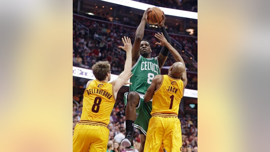 Boston Celtics' Jeff Green (8) drives to the basket between Cleveland Cavaliers' Matthew Dellavedova (8) and Jarrett Jack (1) during the first quarter of an NBA basketball game Saturday, April 12, 2014, in Cleveland. (AP Photo/Tony Dejak)