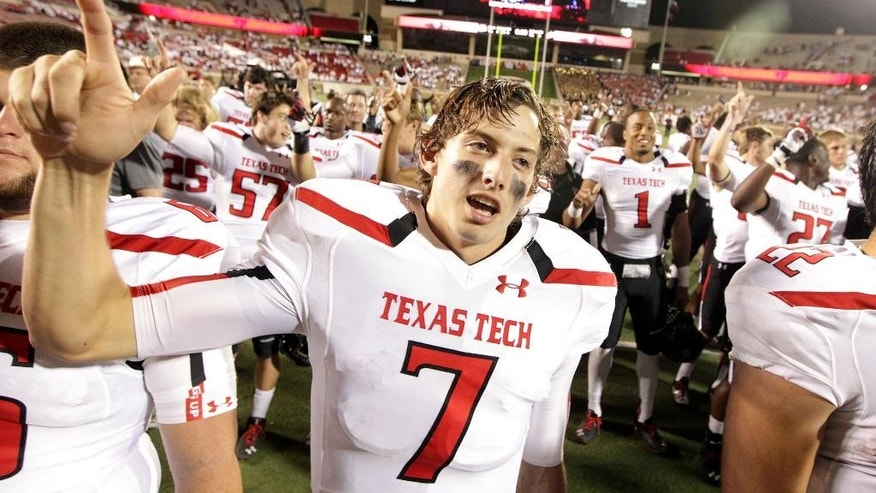 FILE - In this Sept. 21, 2013 file photo, Texas Tech's Davis Webb (7) celebrates a win over Texas State after the NCAA college football game in Lubbock, Texas. Last season true freshman Davis Webb battled to become Texas Tech starting quarterback. He ended the season with a stellar performance and the MVP in the Red Raiders Holiday Bowl win.  (AP Photo/Lubbock Avalanche-Journal, Stephen Spillman) ALL LOCAL TV OUT