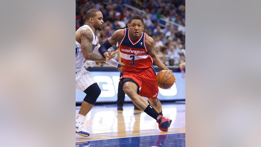 Washington Wizards guard Bradley Beal (3) drives around Orlando Magic guard Jameer Nelson during the first half of an NBA basketball game in Orlando, Fla., Friday, April 11, 2014. (AP Photo/Reinhold Matay)