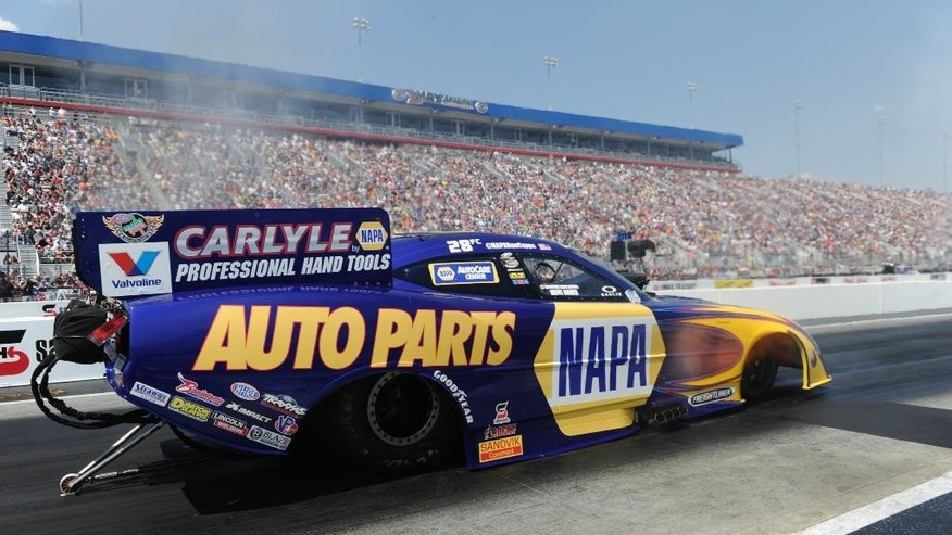 In this photo provided by NHRA, Funny Car driver Ron Capps secured the No. 1 qualifying position in his NAPA Auto Parts Dodge Charger at the fifth annual NHRA Four-Wide Nationals, Saturday, April 12, 2014, at zMAX Dragway in Concord, N.C. (AP Photo/NHRA, Marc Gewertz)