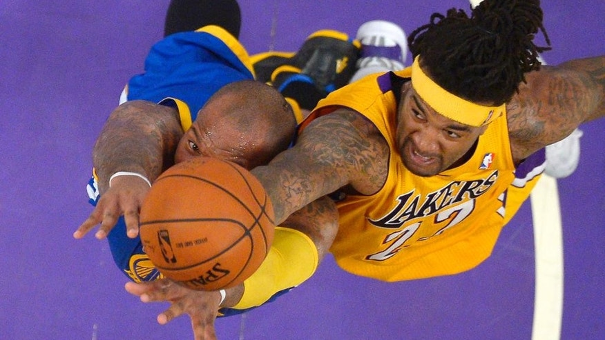 Golden State Warriors forward Marreese Speights, left, and Los Angeles Lakers forward Jordan Hill reach for a rebound during the first half of an NBA basketball game, Friday, April 11, 2014, in Los Angeles. (AP Photo/Mark J. Terrill)