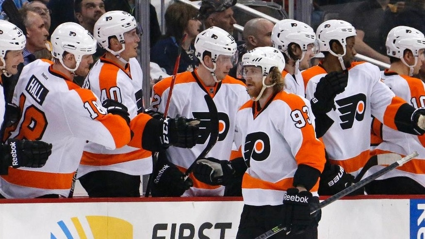 Philadelphia Flyers' Jakub Voracek (93) celebrates with teammates after scoring in the second period of an NHL hockey game against the Pittsburgh Penguins in Pittsburgh, Saturday, April 12, 2014. It was his second goal of the game. (AP Photo/Gene J. Puskar)